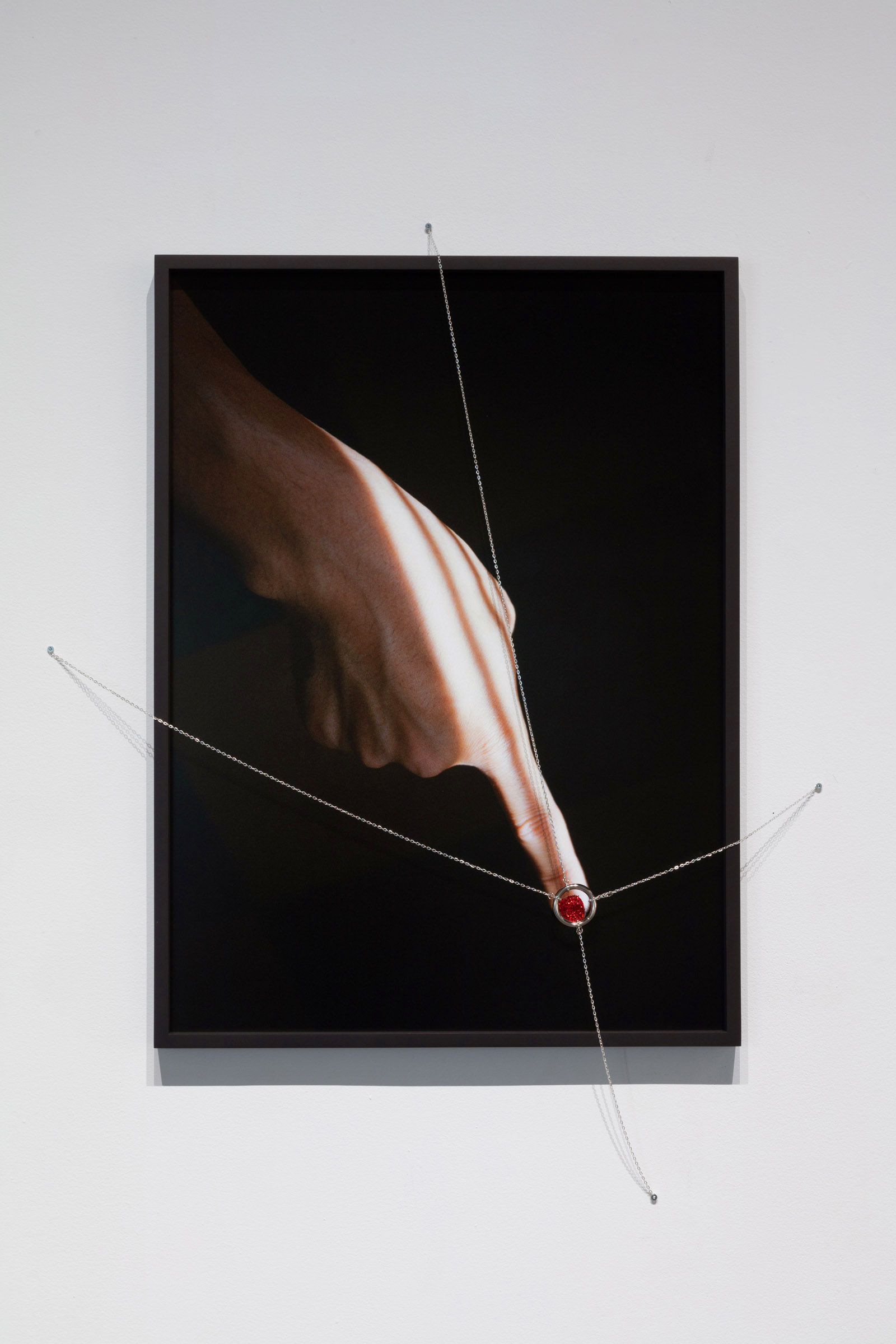 <i>Turning Point</i><br>2020<br>Framed photograph, silver chain, ring and nail polish<br>30.75